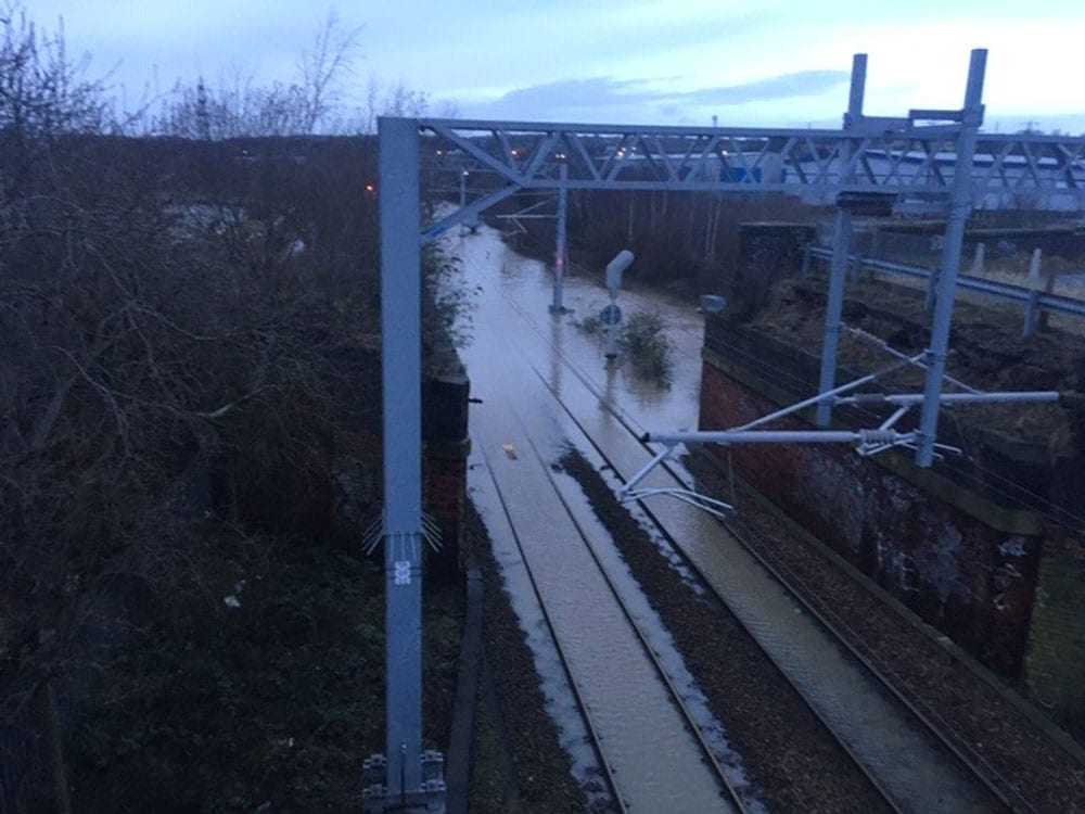 Storm Dennis is continuing to cause transport chaos as train lines and roads are blocked by flooding and fallen trees.